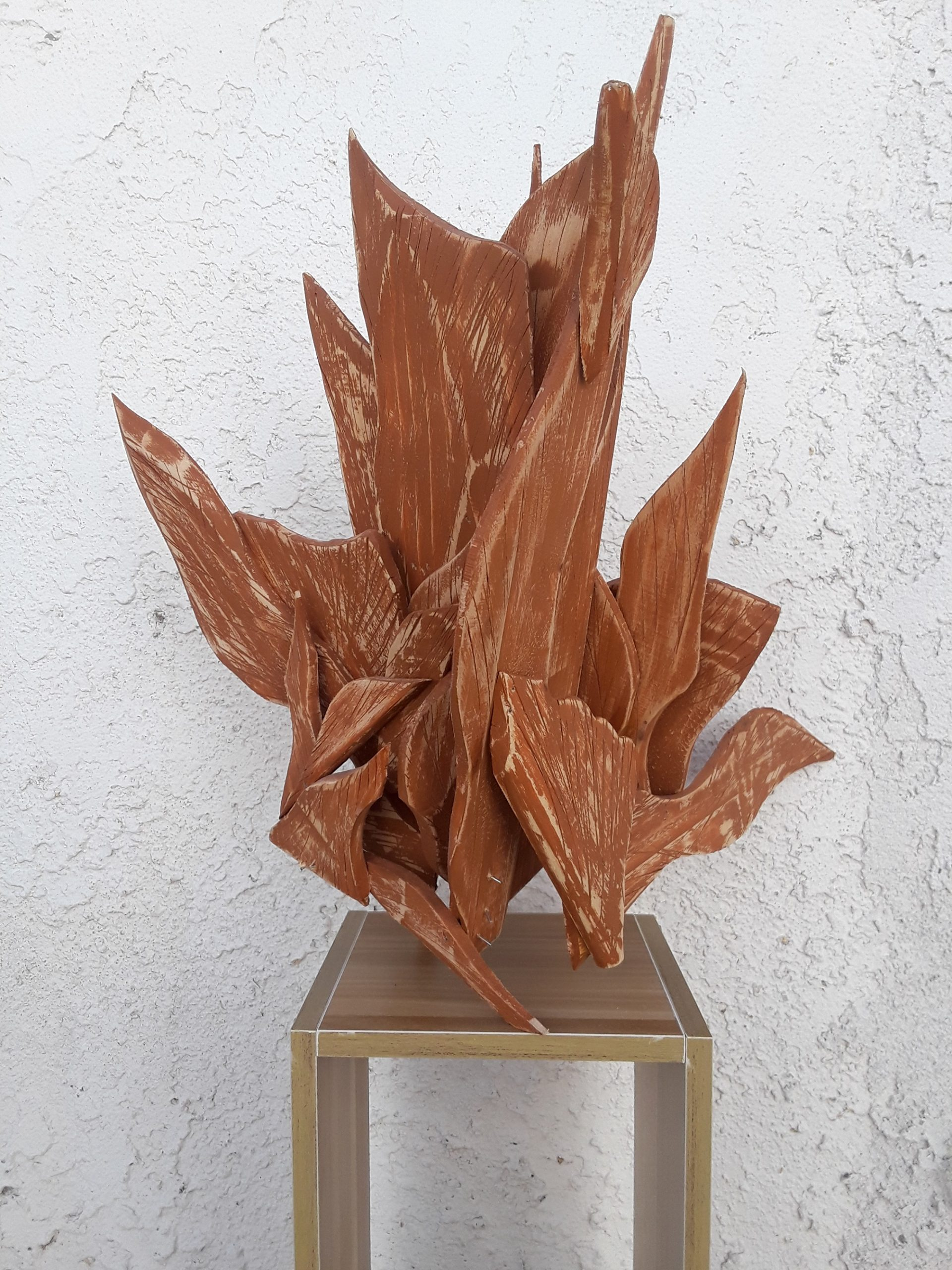 Different shapes of wood put together to create an abstract shape.