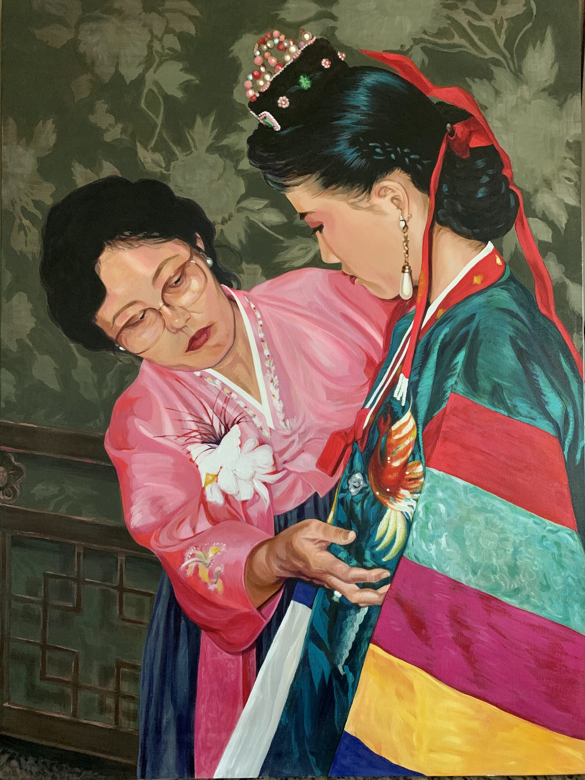 Both women wearing korean traditional clothes painting