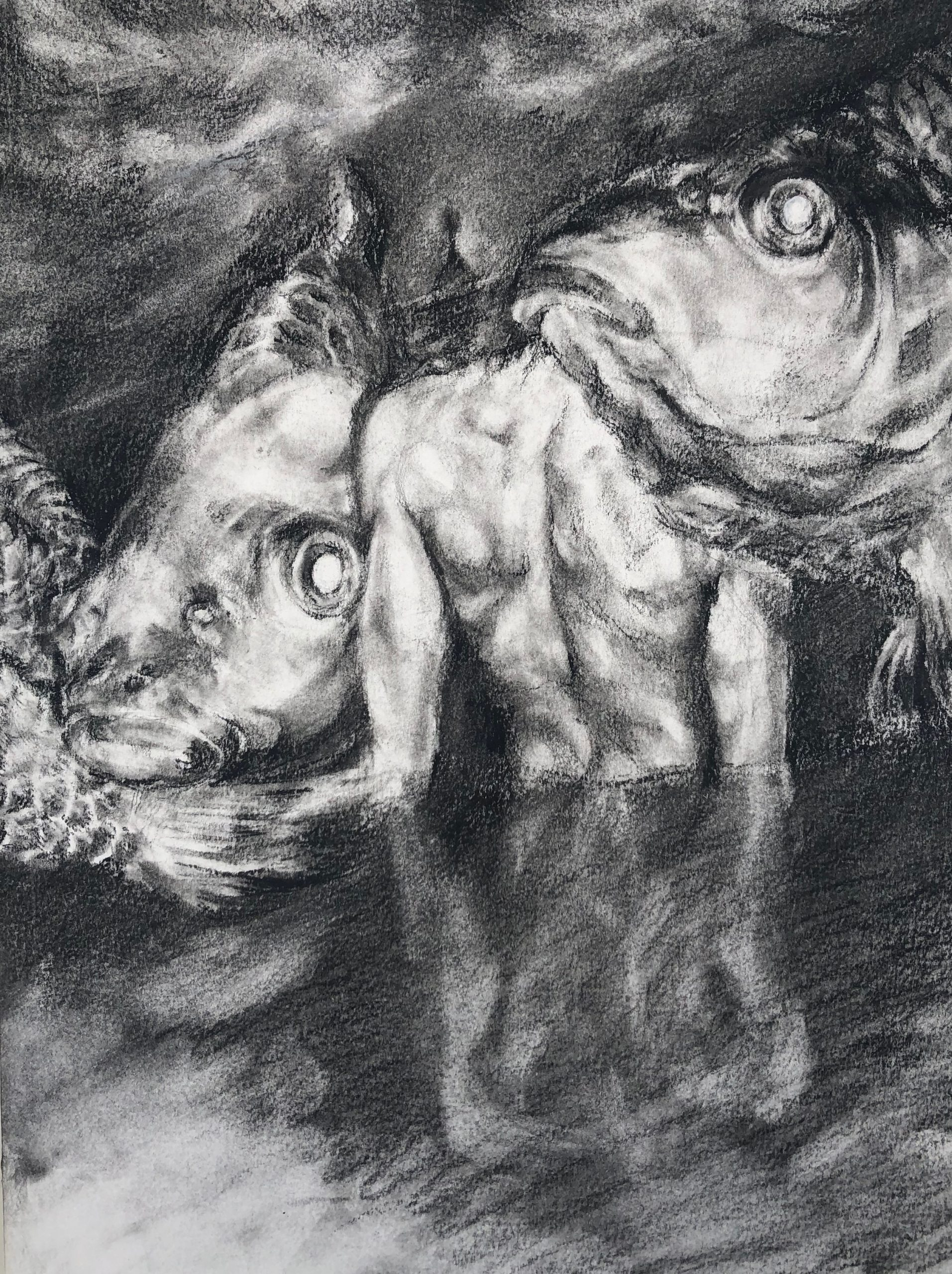 A charcoal drawing of a person in the water between two fishes.