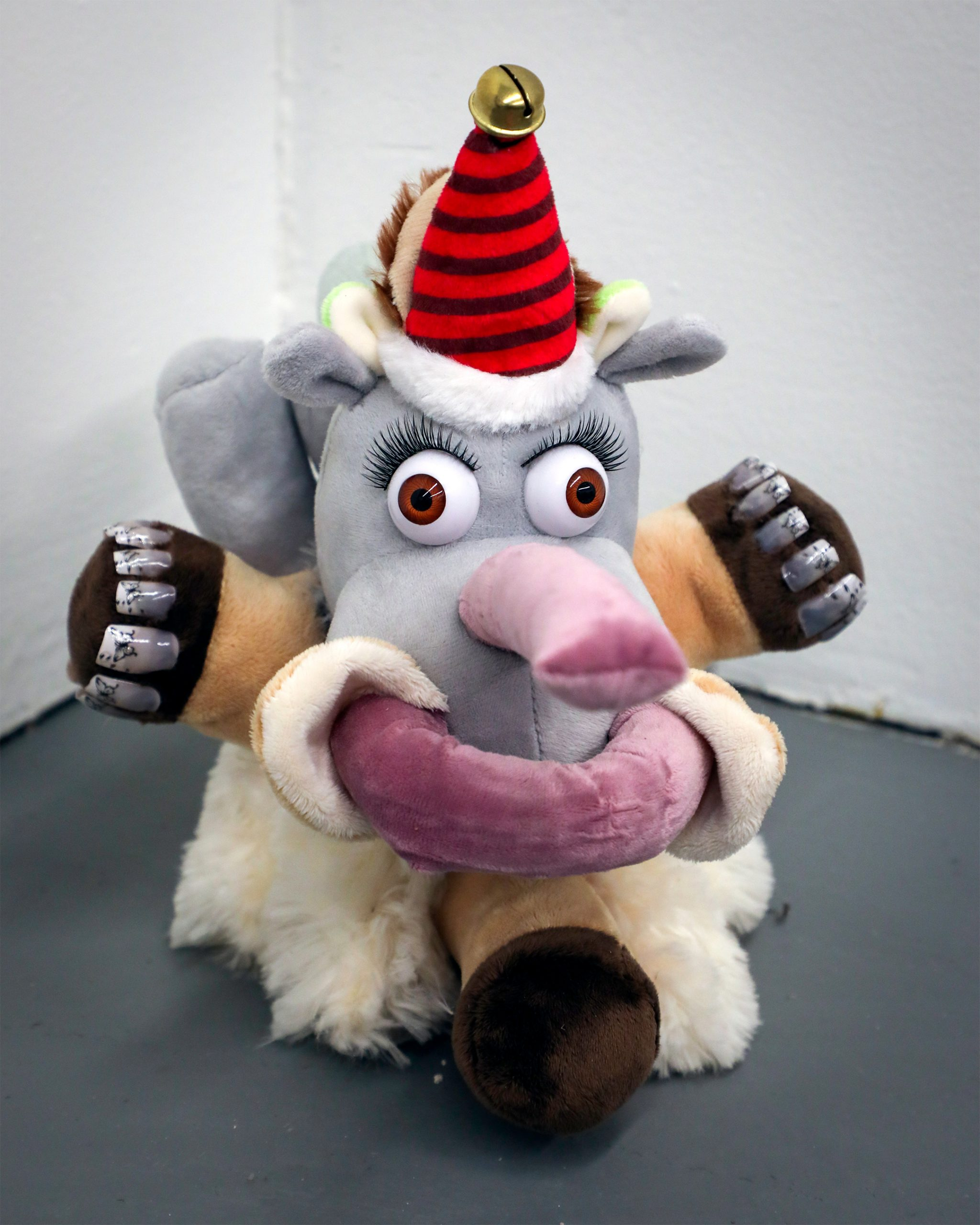 stuffed animal with a red hat and one leg