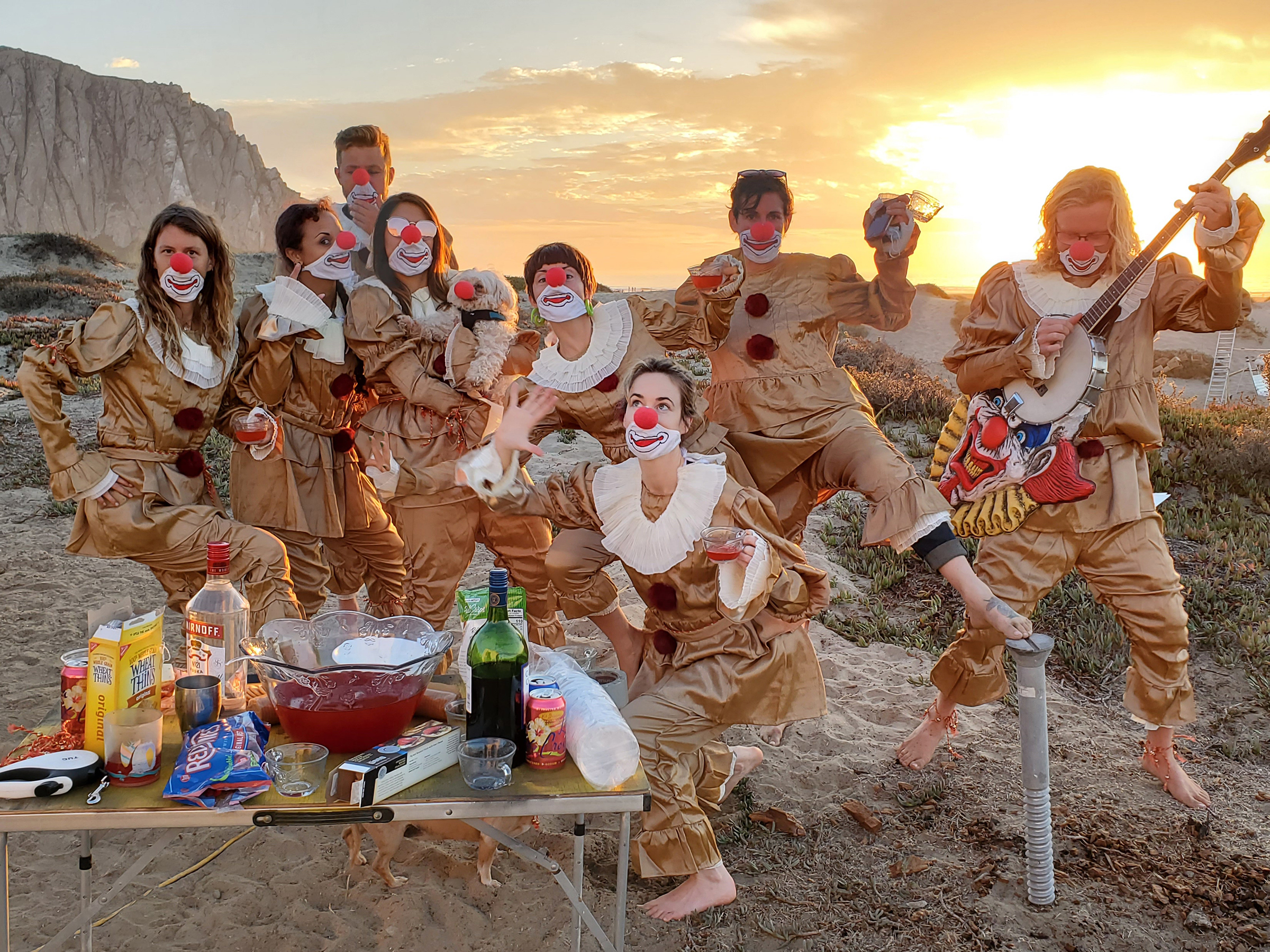 group of people dressed as clowns partying