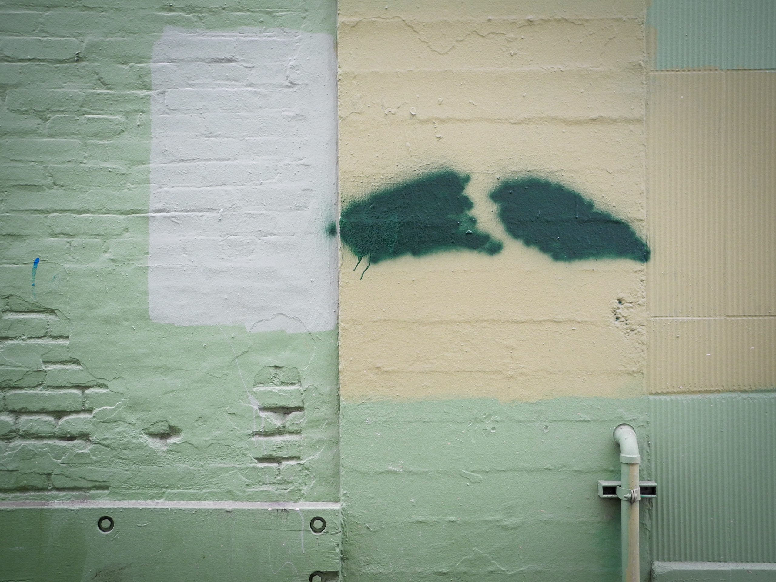 a cool colored photograph of a wall that is painted with teal